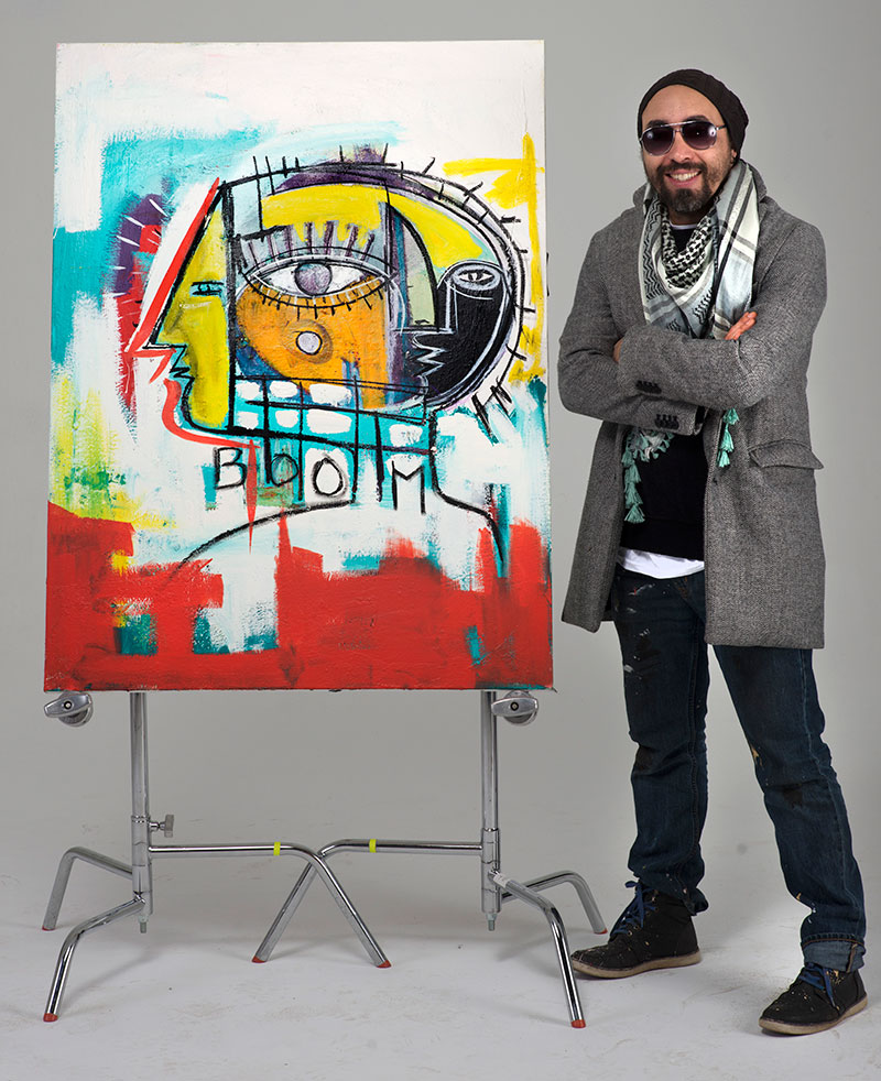 Nico Amortegui with painting